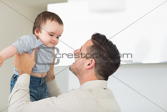 Father playing with cute baby