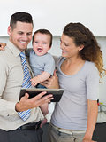 Businessman with digital tablet and family