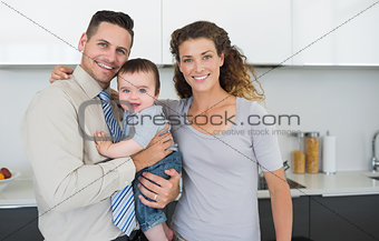Smiling parents with cute baby boy