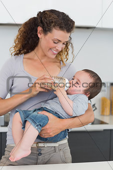 Woman feeding milk to baby