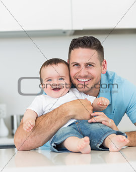 Happy father embracing baby