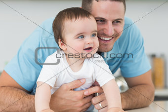Father and baby lying on floor