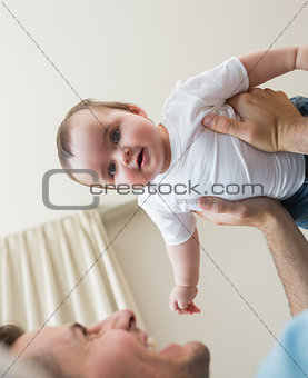 Adorable baby being carried by father