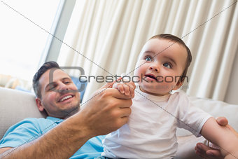 Happy father with baby at home