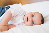 Baby lying in bed