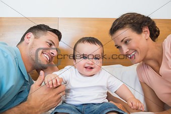 Cheerful baby with parents