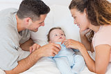 Happy parents playing with baby boy