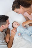 Caring parents with baby boy