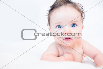 Lovely baby with blue eyes in bed