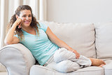 Beautiful woman relaxing on sofa