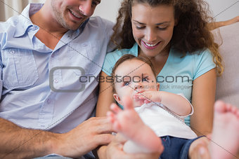 Parents looking at cute baby