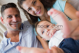 Smiling parents with cute baby