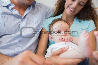 Cute baby sitting with parents