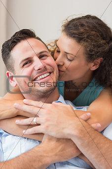 Romantic woman kissing man