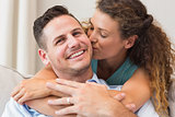 Loving woman kissing man