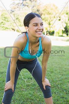 Sporty woman listening music