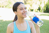 Portrait of sporty woman drinking water