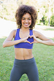 Sporty woman showing heart shape