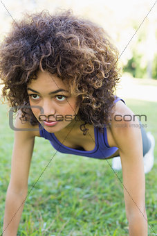 Dedicated woman doing push ups in park