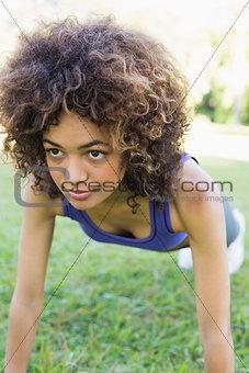Dedicated woman doing push ups in park