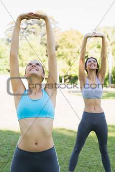 Sporty young women exercising