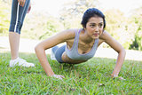 Dedicated woman doing push ups