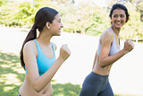 Happy sporty women jogging