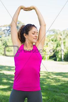 Beautiful woman exercising in park