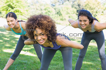 Smiling sporty women exercising