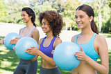 Sporty women exercising with medicine balls