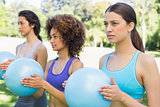 Women exercising with medicine balls