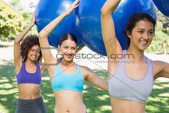Women exercising with fitness balls
