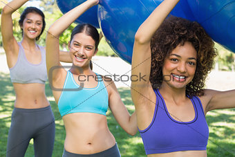 Fit women exercising with fitness balls