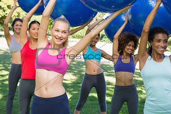 Group of women exercising in park