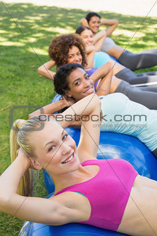 Sporty women balancing on pilates