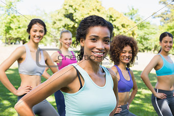 Confident women exercising in park