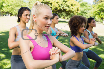 dedicated women exercising in park