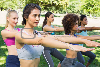 Sporty women doing stretching exercise