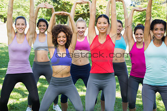 Sporty women stretching at park