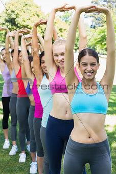 Multiethnic women exercising at park