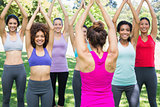 Smiling women exercising with instructor at park