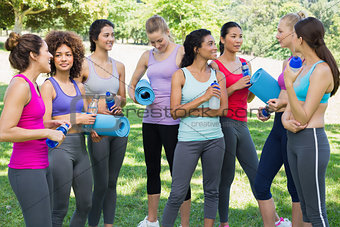 Multiethnic sporty women talking in park