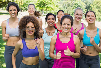 Happy female friends jogging in park