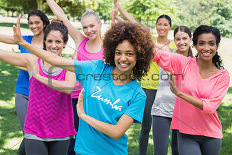 Friends performing Zumba dance in park