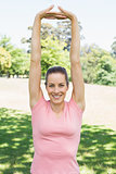 Woman doing stretching exercise at park