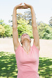 Woman performing stretching exercise at park