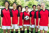 Happy female soccer team at park