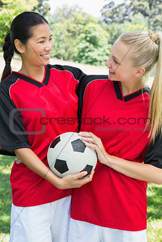 Female soccer players looking at each other