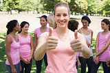 Volunteer gesturing thumbs up at breast cancer campaign