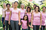 Multiethnic females supporting breast cancer awareness